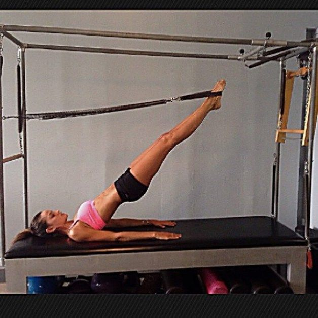 Cadillac Pilates: Working Out On The Pilates Cadillac. This Exercise, Known As The Magician, Uses Leg Springs To