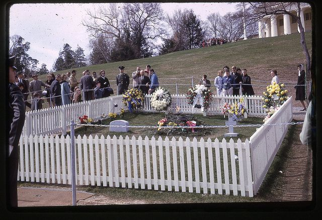 This is the original gravesite of John F. Kennedy. in Arlington National Cemetery.  On the left is the headstone of his son Patrick Bouvier Kennedy, on the right is the cross headstone of his still-born daughter Arabella.  JFK assassination, November 22, 1963; funeral Nov 25, 1963; children reburied December 5, 1963; all three moved to permanent gravesite March 15, 1967.Photo David C Cook '64