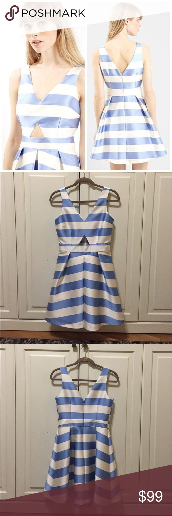 Topshop blue and white striped cocktail dress Perfect for a summer wedding! Topshop Blue and white striped dress. Front cutout detail. Zipper back. ONLY WORN ONCE! Excellent condition! Topshop Dresses