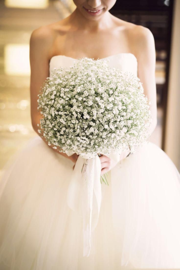 We love this baby's breath bridal bouquet! The romantic trailing tulle ribbon totally enhances its perfection!
