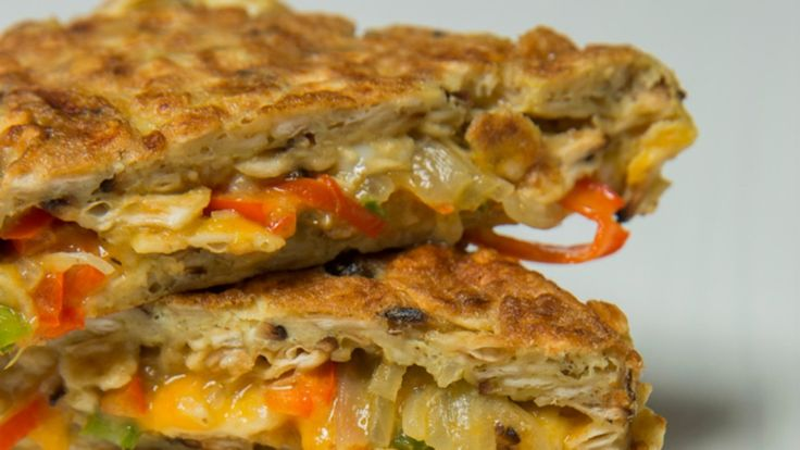 Hidden within what looks like your Bubby's matzo brei is an oozy cheddar filling studded with sautéed peppers and onions. Serve with sour cream on the side.