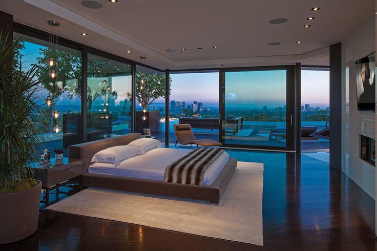 An exquisite modern master bedroom interior with an amazing landscape view | Discover more: http://masterbedroomideas.eu/