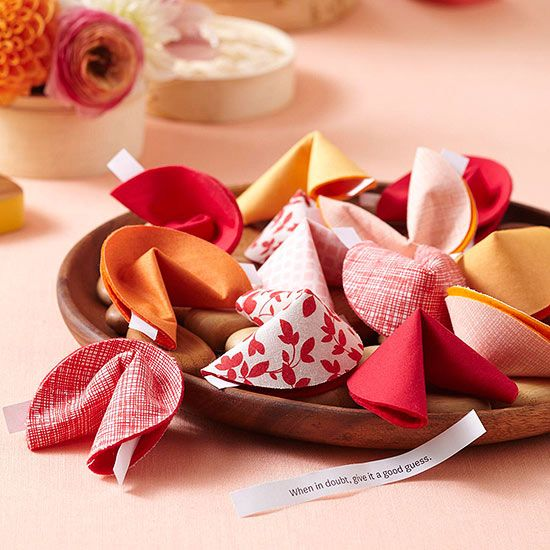 "Make Fortune Cookie Favors Fortune cookies are a favorite Chinese-inspired American invention. These DIY cloth fortune cookies are fun to make, and they are adorable party favors. Not feeling crafty? The traditional Chinese New Year gift is a red envelope with some ""lucky money"" inside."