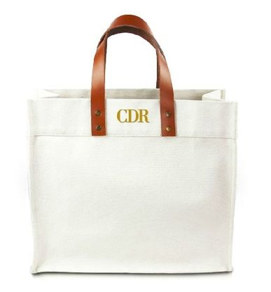 Personalized monogram canvas tote bag with leather straps. Customize this classic, preppy tote with your initials. An ideal destination wedding gift or bridal party gift.