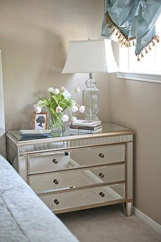 Mirrored chest as bedside table