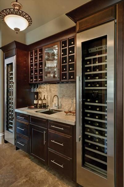"two 18"" wine fridges on end; small square sink; ice maker; beverage cooler drawer;  don't want the wine rack on top - want closed cabinets for booze; glass cabinet middle for stemware"