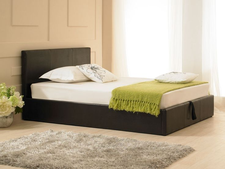 The Madrid Ottoman bed frame in a black faux leather is a fantastic design and would grace either a modern or traditional room setting.