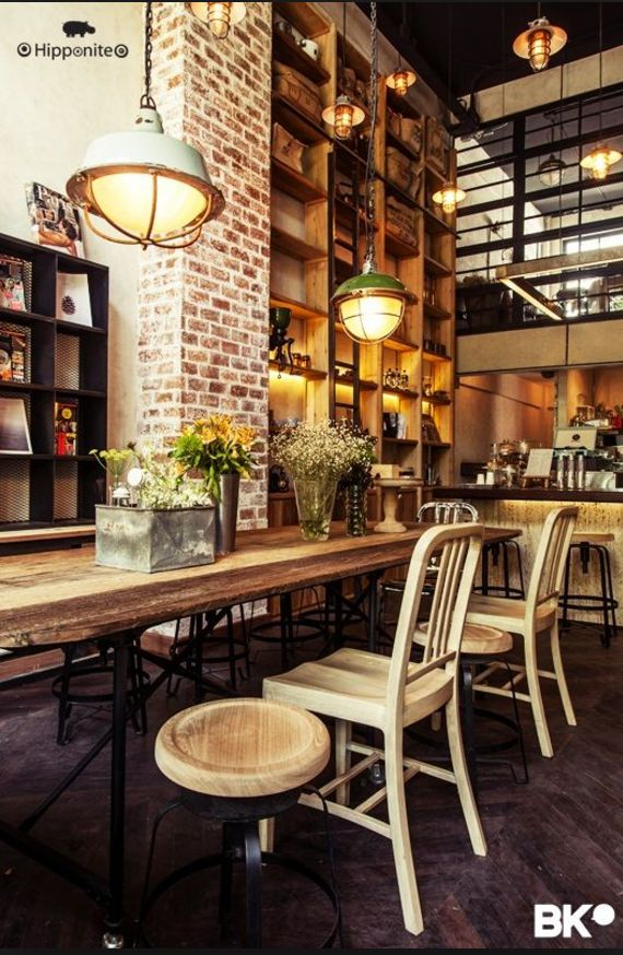 Brick wood and mix of chairs restaurant interiors