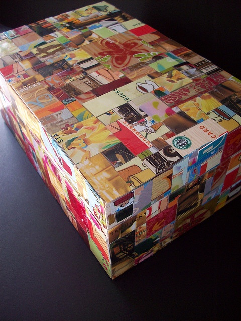 Wooden box covered with repurposed starbucks gift cards.