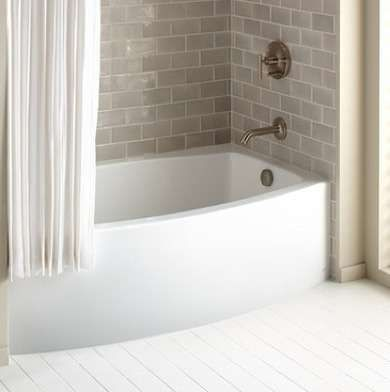"Supersize Your Small Bath with These 8 Pro Tips  -  Aim for Average  ""A too-big tub is a real space waster,"" says Lamarre. ""Most people sit upright in the tub, so a 5-foot tub is sufficient for practically everyone. There are all kinds of ways to use the space that you save with a smaller tub,"" such as adding a mini storage unit. ""The more you can build in, the better."