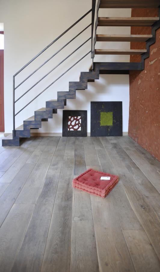 vintage wooden floor + iron staircase