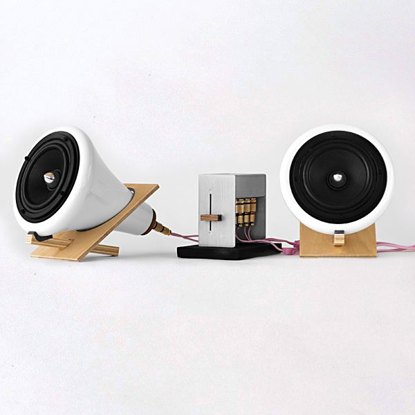 "San Francisco based designer Joey Roth created this ceramic speaker system to convey the warmth and human feeling of good music. System includes two ceramic speakers, amplifier based on the Tripath 2024 T-Amp with gold-plated binding posts, 1/8"" input, cast iron base, 16-gauge oxygen-free copper speaker cables with banana plug termination plus interconnects for RCA and 1/8"" sources."