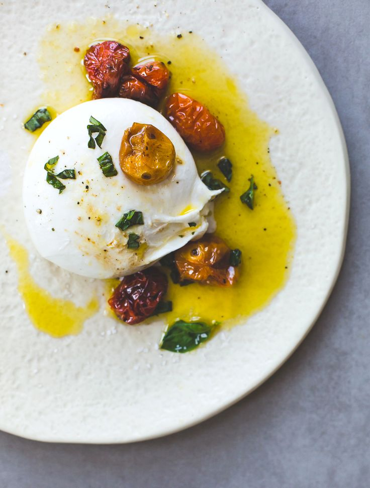 Soft & creamy burrata cheese topped with slow-roasted cherry tomatoes, olive oil, & basil, an incredible summer appetizer. Can use buffalo mozzarella.