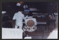 Elvis Presley and Charlie Hodge - unusual angle of stage performance - Elvis at the piano - Charlie holding the mic