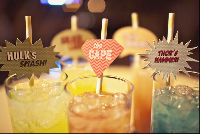 Heroic party straws with colorful drinks.
