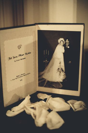 Framed. Use old books as creative frames for pics of you and your man or of couples in the two families.