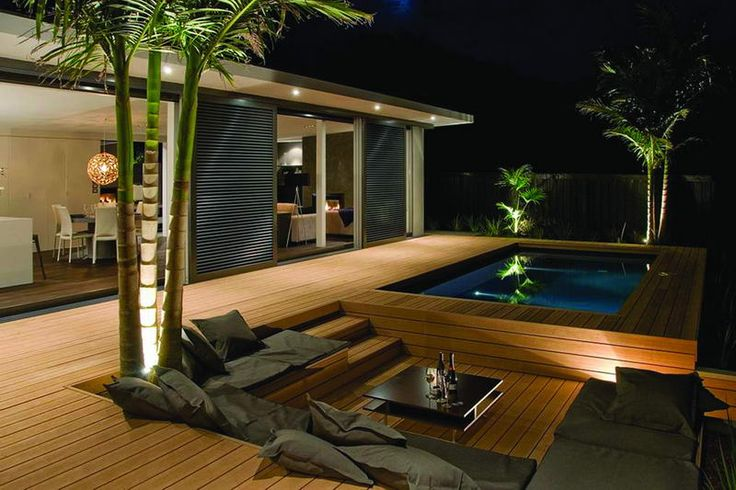 Decking with sunken seating area and raised pool patios for Sunken seating