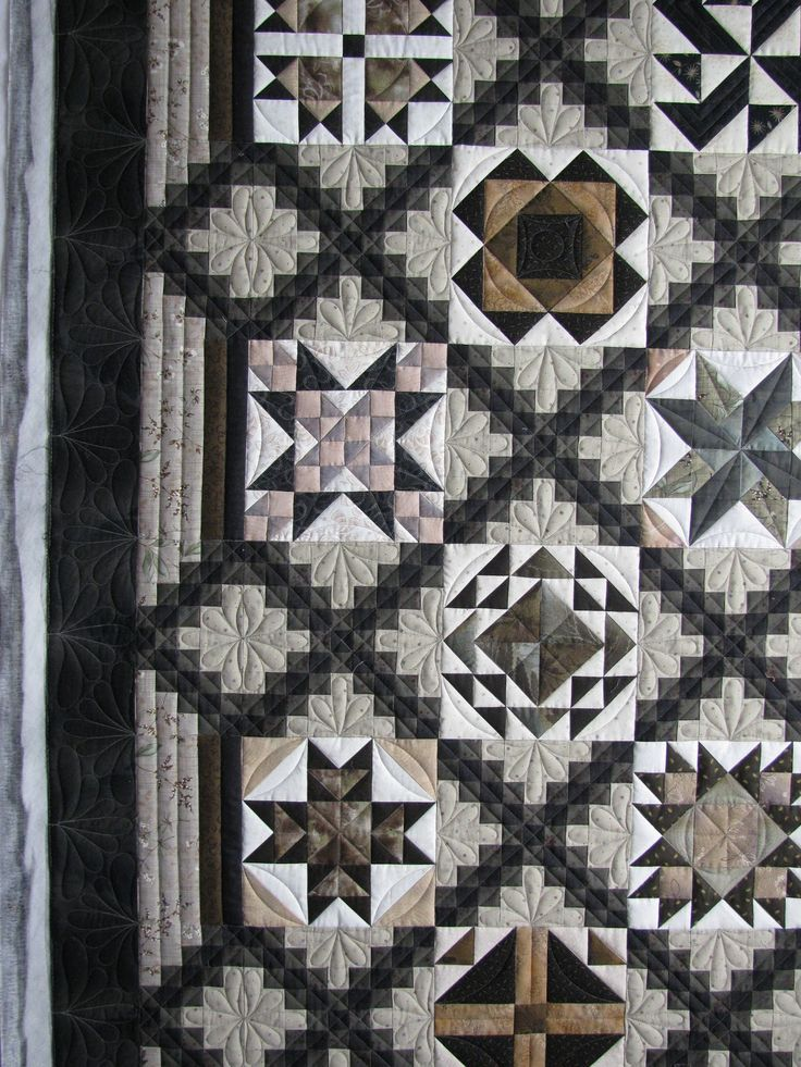 I love this quilt that Ann made for her son - her piecing is wonderful and I love the Japanese taupe-y fabrics.  She likes me to use wool ...