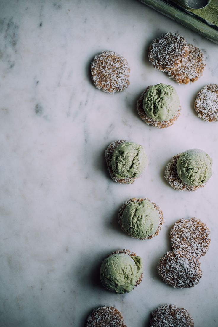 Simple, 10-ingredient raw vegan matcha ice cream sandwiches! Made mostly of coconut and dates. Coconut macaroon cookies, green tea coconut milk ice cream.