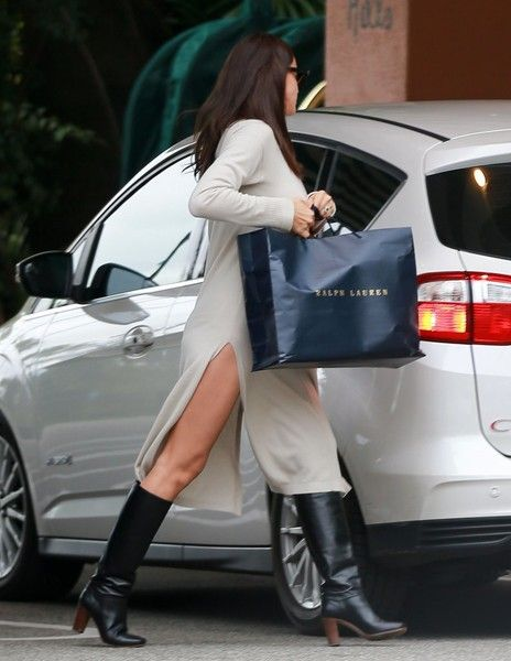 Pregnant model Irina Shayk is spotted returning to the Beverly Hills Hotel after doing some holiday shopping on December 21, 2016 in Beverly Hills, California. Irina, who is expecting her first child with actor Bradley Cooper, could be a seen sporting an emerald ring on her left hand during the outing.