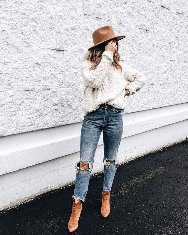 Minimal fall outfit. Tan fedora, cream pullover, light denim jeans, tan bkkts