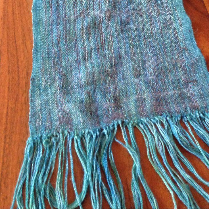 Green Malabrigo hand woven merino silk scarf.  Length 115cm (135cm with tassels) x 22cm wide.