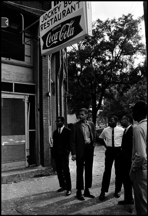 Civil rights activists Jimmy Hicks, Julian Bond, John Lewis, and Jeremiah X stand across the street from a bombed church where 4 young black girls were killed while attending Sunday school. Birmingham, Alabama, 1963
