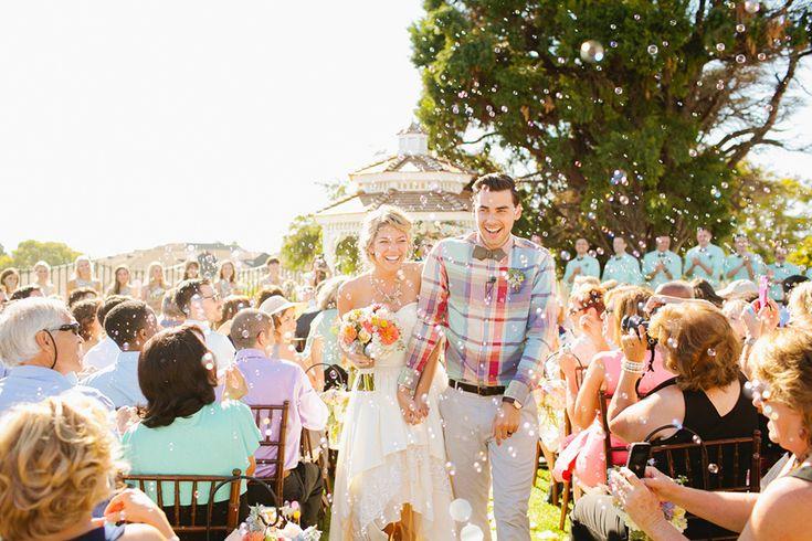 Bubbles instead of rice toss Cook Wedding | http://masonandmegan.com/wedding/cook-wedding-newland-barn-huntington-beach/