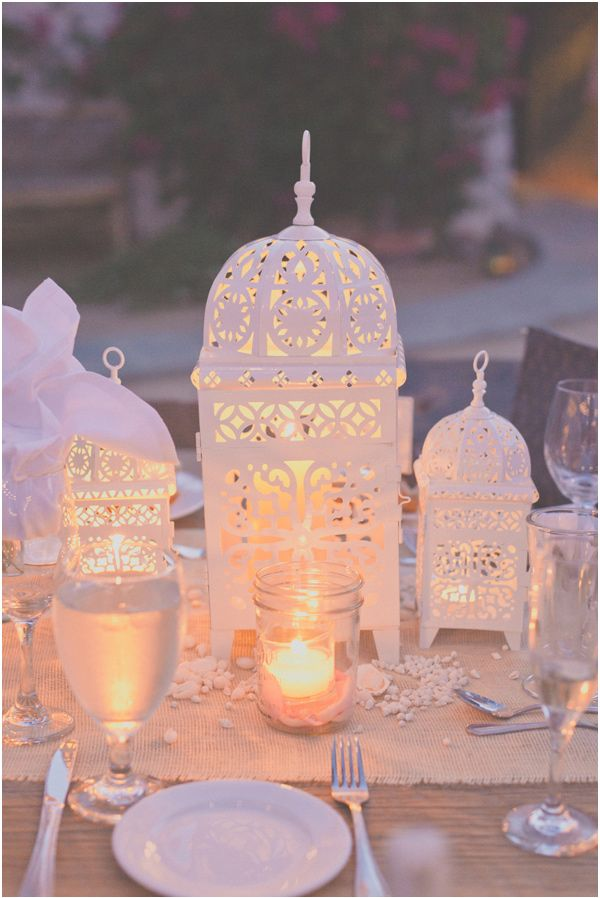 Gorgeous, white, Moroccan lanterns for an elegant wedding reception table setup