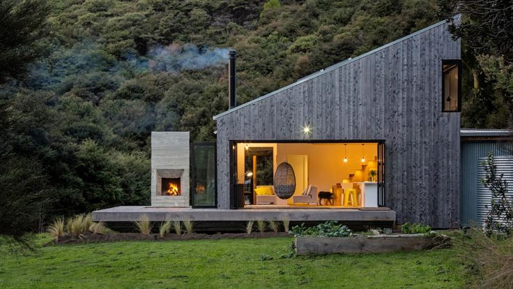 A strong building for a tough landscape - this stunning bach in the bush is a major ADNZ award winner.