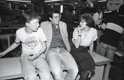 John Hughes on the set of The Breakfast Club with Molly Ringwald and Anthony Michael Hall