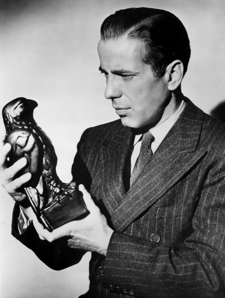 Image result for a picture of humphrey bogart holding the maltese falcon