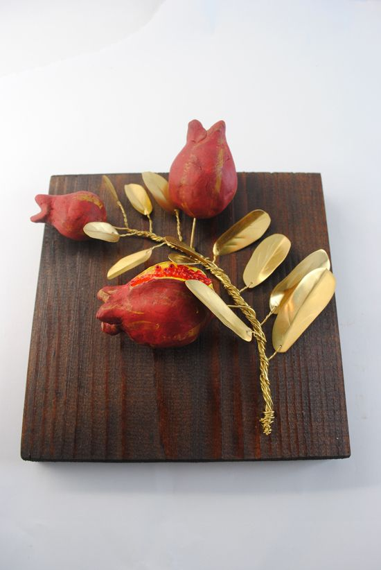 Wooden frame with branches pomegranates of bronze