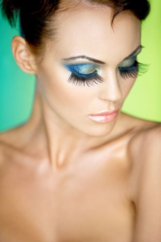 Artificial eyelashes and blue eye shadow