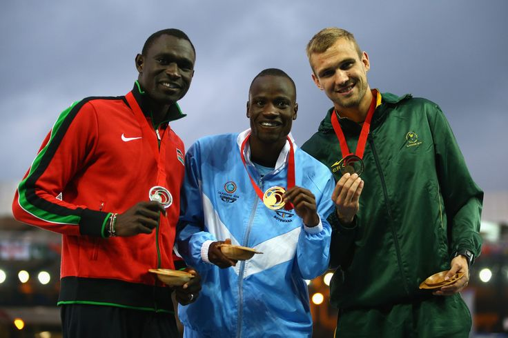 800m track (L-R) Silver medallist David Rudisha of Kenya, gold medallist Nijel Amos of Botswana and bronze medallist Andre Olivier of South Africa