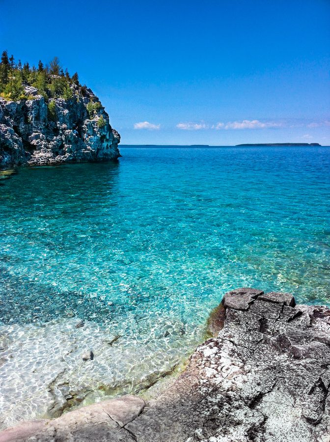 Bruce Peninsula, Ontario, CA. Amazing blue waters, crisp clean air, and charming little towns all along the peninsula. Plenty of hiking trails for outdoor enthusiasts.