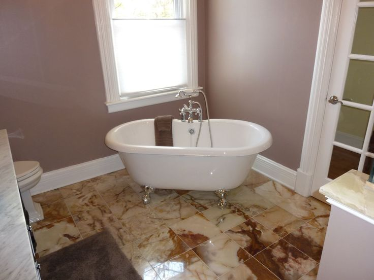 Claw Foot Tub, Marble Tile Floor, Mauve Walls