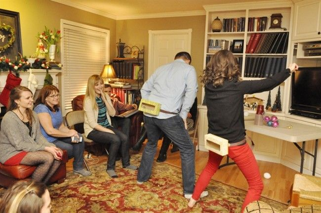 Christmas Themed Games - Jingle In The Trunk: tie a Kleenex box to the backside of each person, and fill the Kleenex box with 8 jingle bells. Have the players shake their hips to try to bounce the bells out of the box..first one to et all their bells out is the winner.