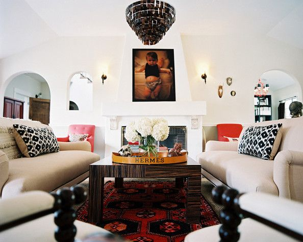 Like the sofas, child portrait and small fixtures above the mantel