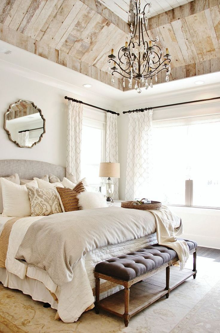 Chic Bedroom With Neutral Wall Color And Chandelier Over King Size Bed And Using Wall Mounted Mirror