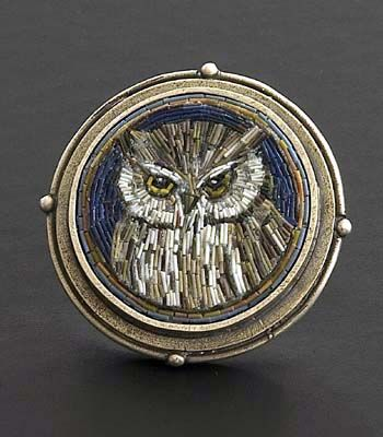 """Cynthia Toops: Owl Brooch, Small round mosaic brooch in polymer micro mosaic. Sterling silver bezel by Chuck Domitrovich. 1 1/8"""" diameter."""