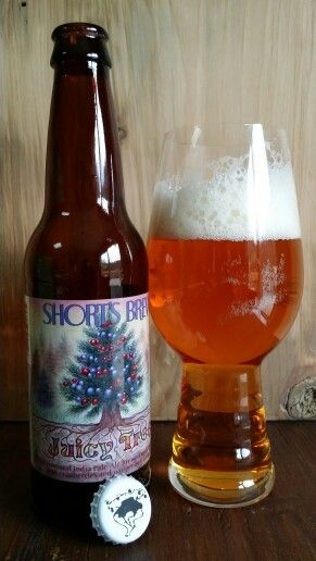"Short's Brewing Co.'s Juicy Tree. An ""experimental"" IPA made with juniper berries and cranberries. Similar to finding out about Santa Claus, this is a shock to the taste buds (the juniper stands out), but stick with it and it becomes an interesting, even enjoyable brew."