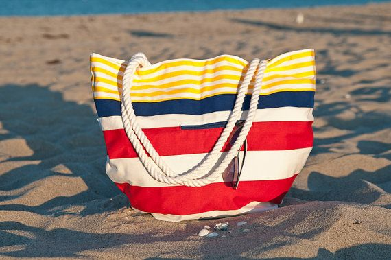 A nautical striped beach tote with rope handles