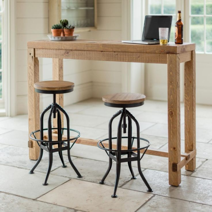 A tall bar table handcrafted from reclaimed pine in a contemporary design. Ideal as a breakfast bar or for social occasions. Handmade in Vietnam. Fair Trade.