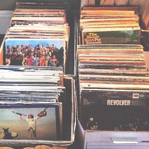 box of records next to record player... romantic and classic songs to play during reception