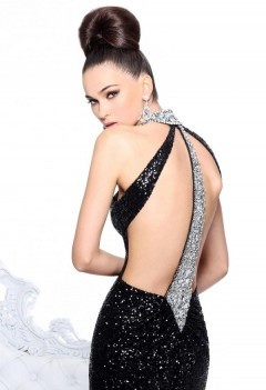 DCSH21129 The choker-style neckline and asymmetrical back straps are embellished with intricate beads. This fully sequined ensemble is sensational with its open back design and keyhole detail while its straight skirt with train finely trails down to the floor. Available Colour: Black/Silver.