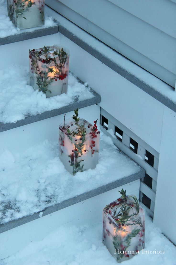 These luminaries are made with empty wine bottles and half-gallon milk cartons. After the initial freeze the wine bottles were removes and more water was added to raise the bottom level to conveniently hold a votive candle.