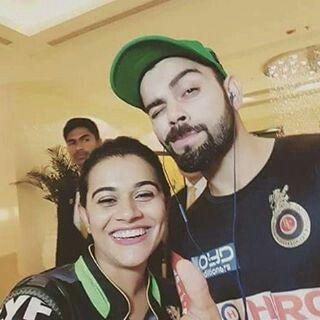 Virat kohli with a lucky fan