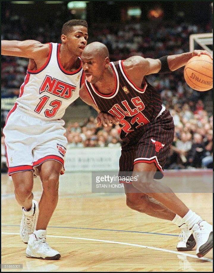 News Photo : Michael Jordan of the Chicago Bulls drives...