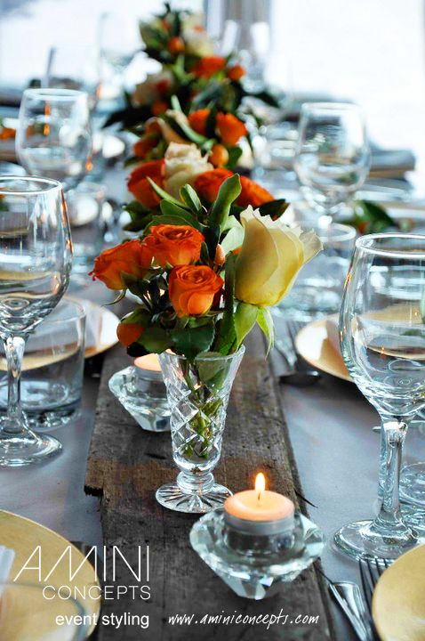 Florals on driftwood. Oranges and browns looked stunning! #styling #events #weddings #tablesetting #eventstyling #australia #brisbane #queensland #flowers #bouquets #floralarrangement